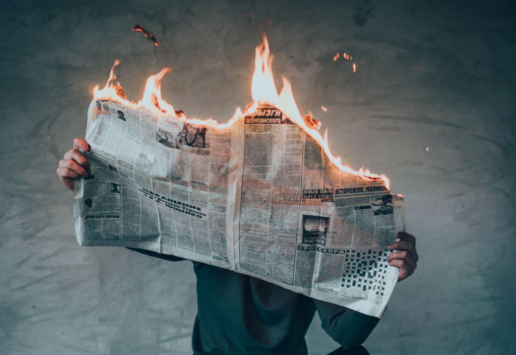 Bath Digital Festival - Man holding burning newspaper