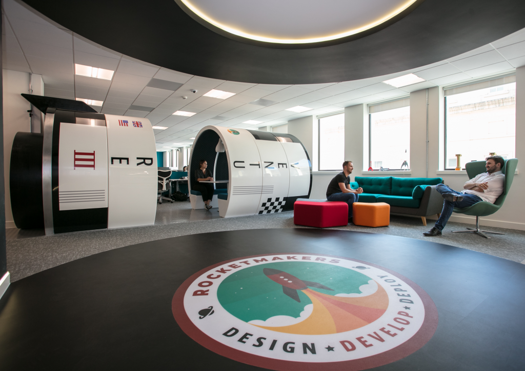 Bath Creative Agency Rocketmakers office, the rocketmakers logo is imprinted on the floor and a large rocketshape workspace is in plain view.